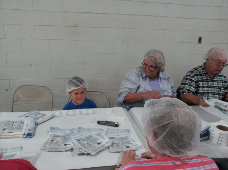 My grandson helping attach labels to MannaPack food baggies